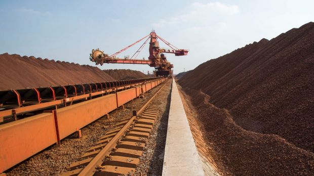 Iron ore prices have fallen off a cliff - and now companies like Fortescue are cutting costs and sackicng staff.