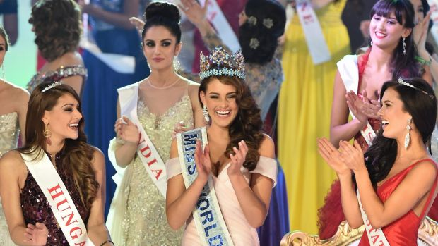 On top of the world: Rolene Strauss celebrates with Miss Hungary and Miss United States as Miss India looks on.