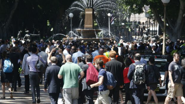 People are evacuated to Hyde Park during a siege in Martin Place.