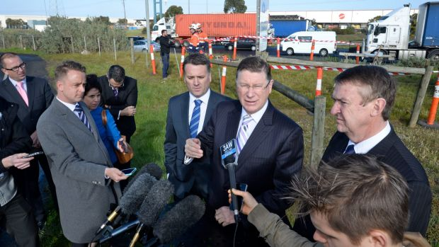 Former premier Denis Napthine, flanked by federal Infrastructure Minister Jamie Briggs and former transport minister ...