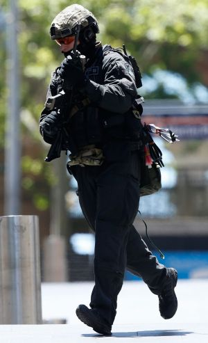 A police officer at the scene of the siege in Sydney.