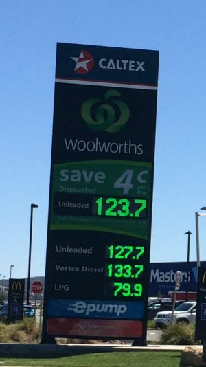 The electronic advertising sign outside the service station on Monday morning showing unleaded petrol at 123.7 cents per ...