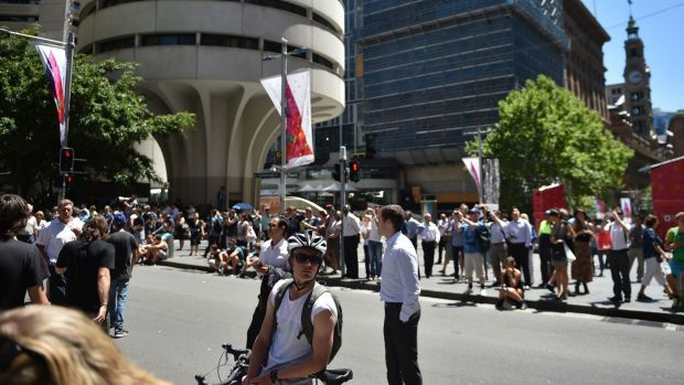 Workers gather at Martin Place during the siege at the nearby Lindt cafe.