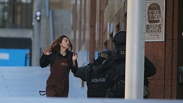 A Lindt cafe worker flees to safety.
