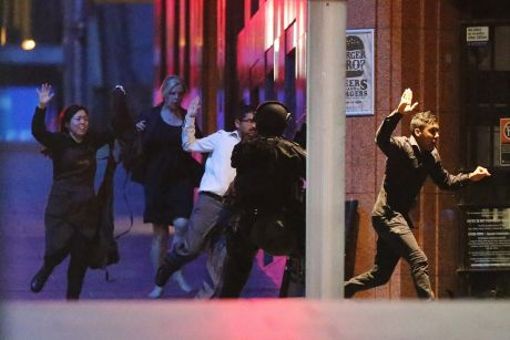 Hostages flee the Lindt Cafe during the siege on December 15, 2014.