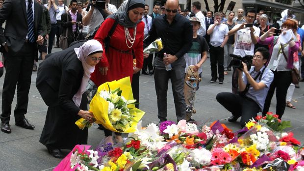 Members of the Muslim community lay flowers at Martin Place after two people were killed during the siege.