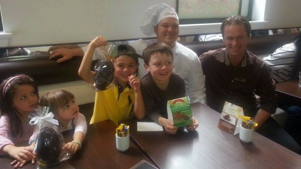 Children (from left) Paige Rowney, Kate Hinchcliff, Henry Hinchcliff and Zachary Rowney with a Lindt chef and manager ...