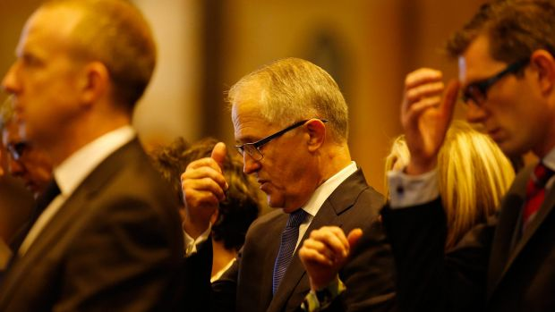 Australian Minister of Communications Malcolm Turnbull attends a mass to pay respect to the victims of the Martin Place ...
