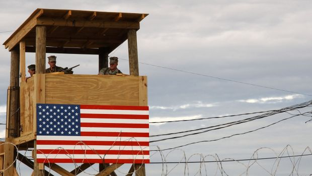 "US troops on watch at their naval base on Guantanamo Bay in January 2002, when the first detainees in the ""war on ..."