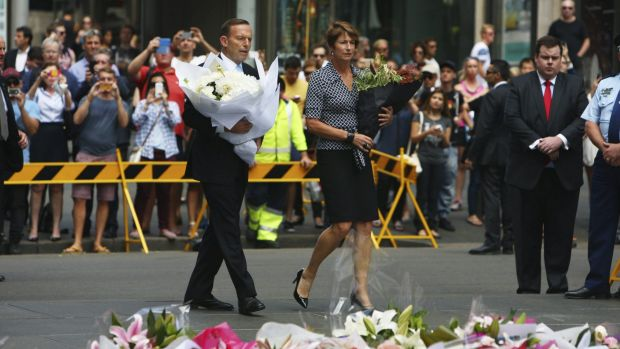 Prime Minister Tony Abbott and his wife Margie pay their respects to the victims of the Martin Place siege.