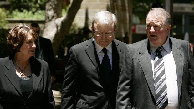 Then Prime Minister Kevin Rudd walks with Marjorie and John Worsley following the funeral for their son Luke in 2007.