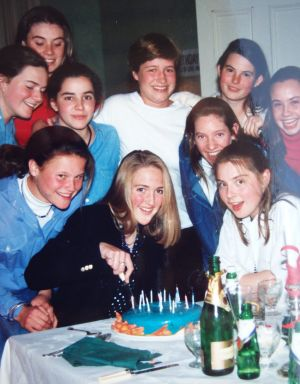 Bee Alexander, far left in middle row, at a surprise party for Katrina Dawson who is cutting the cake on her 15th or ...