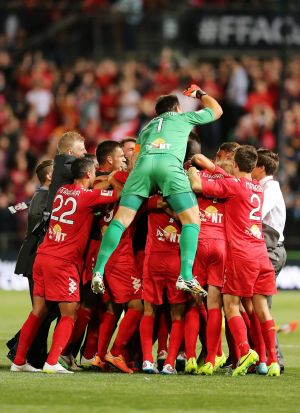 Time to celebrate: Adelaide United claimed their first silverware in seven years.