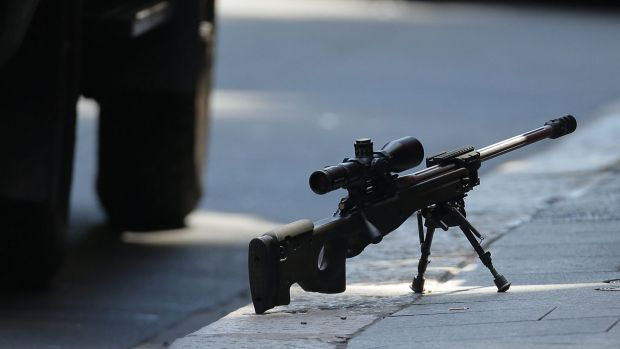 A sniper's rifle on the ground in Phillip Street during the Lindt cafe siege.