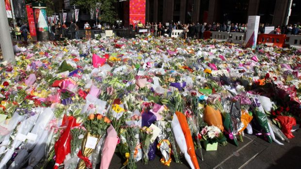 Sea of flowers: The memorial to the victims of the Lindt Chocolat Cafe siege continued to expand in Martin Place on ...