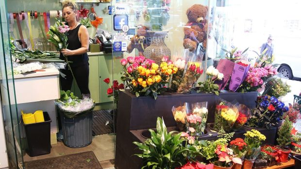 """""""It was hard to keep it together"""": Glasshouse florist owner Tracey Hemus prepares flowers on Wednesday."""