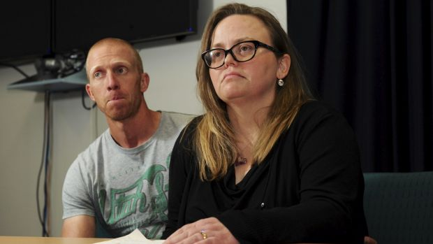 Jenny Heddle, the wife of missing Chisholm man Stuart Heddle, makes a public plea at the Woden Police Station. At left ...