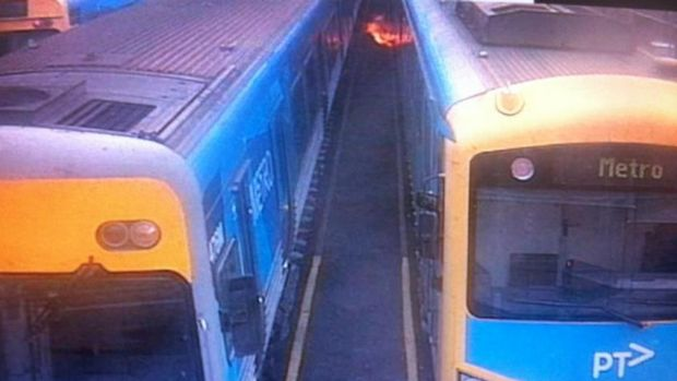 Flames shoot from a train  caused by an electrical fault. The fire did not spread but three trains have been pulled out ...