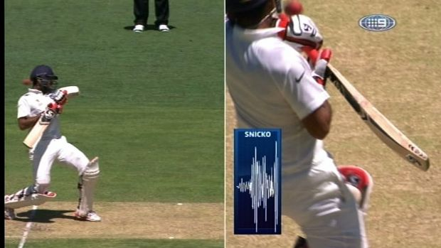 Grilled: Cheteshwar Pujara given out even though ball missed his bat.