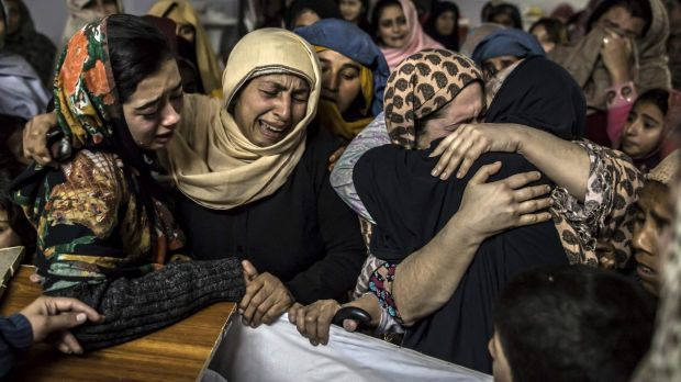 Bloodshed: Relatives mourn over the coffin of Mohammed Ali Khan, 15, after the school massacre in Peshawar.