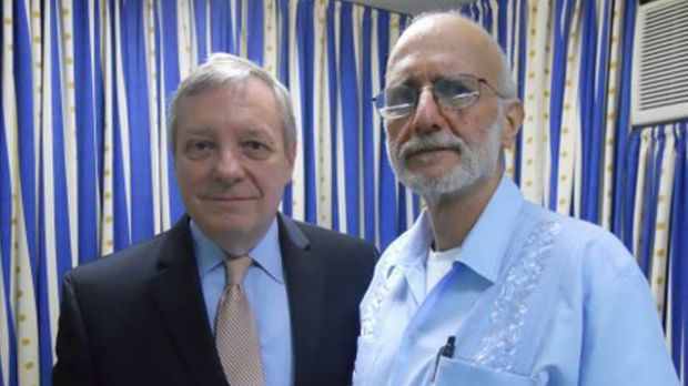 Free after five years ... US Senator Dick Durbin greets former Cuban prisoner Alan Gross after he arrived at Andrews Air ...