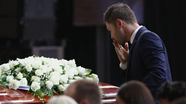Australian cricket captain Michael Clarke pays his respects to fellow Test cricketer Phillip Hughes, who died after a ...
