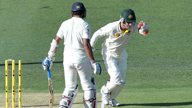 Can you give him two for that? Brad Haddin celebrates taking Murali Vijay's wicket on day one.