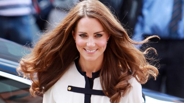 Prince William has mocked Catherine's crowning glory during a tour of a charity centre in London.