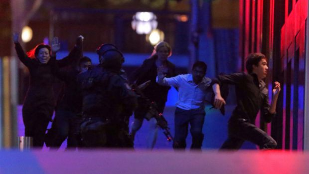 Hostages run from the Lindt cafe on the night of the siege.