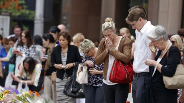 Relatives of siege victim Katrina Dawson gather in Martin Place on Thursday.