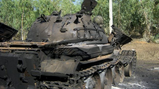 Light armour: A burnt-out armoured personal carrier used by Boko Haram in Mubi, Nigeria, on December 7.