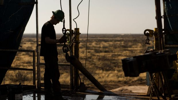 Oil supply continues ... A worker waits to connect a drill bit on the Big Dog Drilling Rig 22 in the Permian basin ...