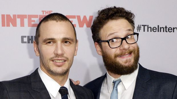 Cast members James Franco and Seth Rogen pose during premiere of the film The Interview.