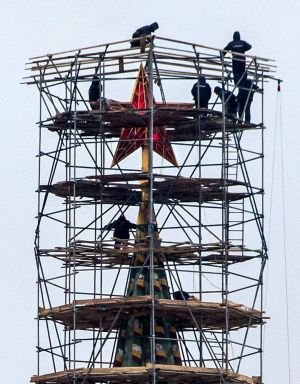 The nature of Russian news has changed. Pictured: workers stand on scaffolding erected around the top of the Spasskaya ...