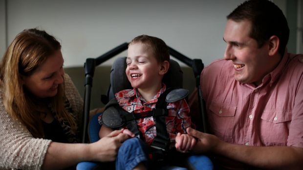 Cooper Wallace, who needs medical cannabis, and his parents Cassie Battena and Rhett Wallace.
