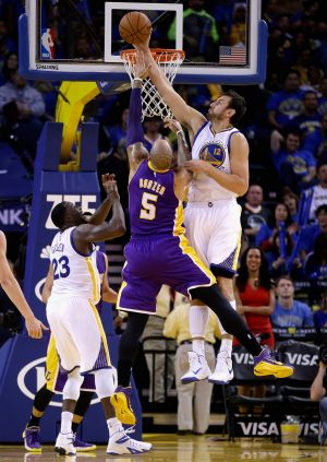 Health worry: Andrew Bogut blocks a shot by Carlos Boozer of the Los Angeles Lakers.