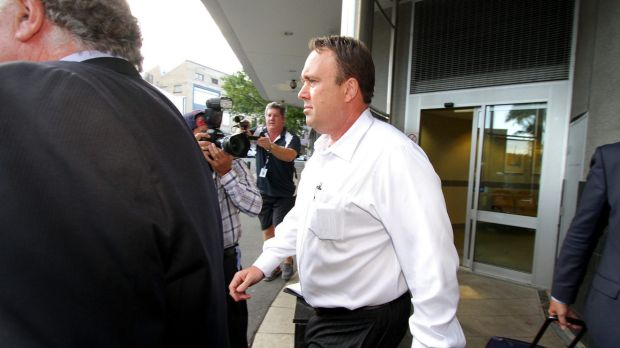 Gold Coast private investigator Mick Featherstone exits the Brisbane Watchhouse after being released on bail on Friday ...