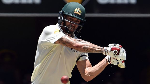 Pugnacious: Mitchell Johnson slams a boundary on his way to a quickfire 88 at the Gabba on Friday.