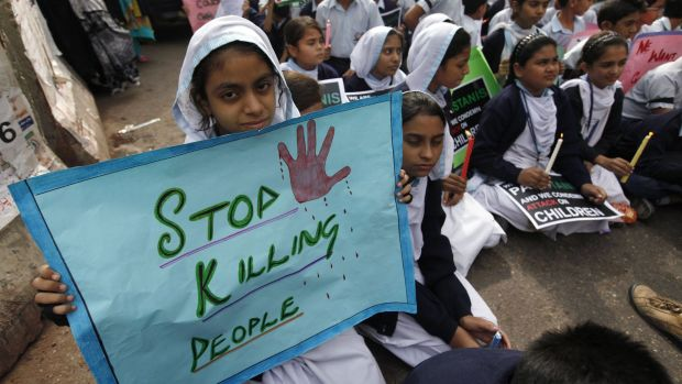 Lost lives: Students hold a vigil for the victims of the Taliban attack on the Army Public School in Peshawar.