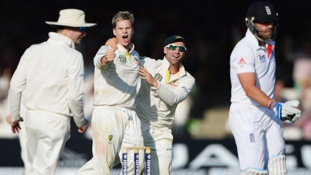 Changing of the guards: Steve Smith takes Matt Prior's wicket in England last year.