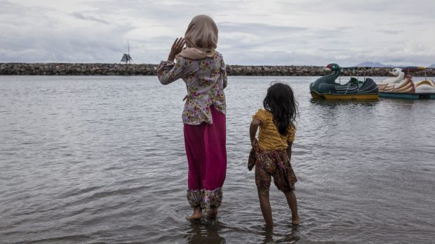 A decade after the tsunami, two girls play on the beach in Banda Aceh.