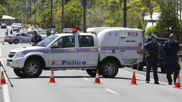 Police at the scene in Murray St, Manoora, in Cairns.
