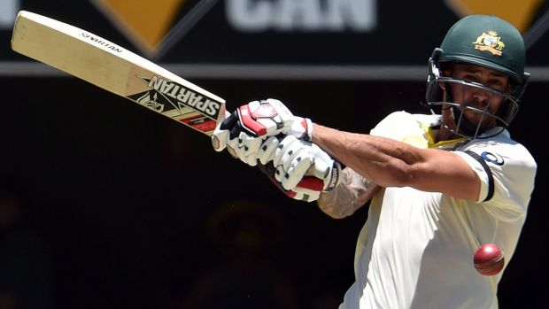 Take that: Mitchell Johnson belts one away during his whirlwind knock.