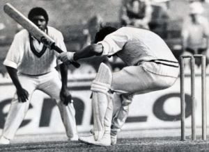 Peter Toohey almost falls backwards as he ducks under a rising ball from West Indian / West Indies Andy Roberts at the SCG.