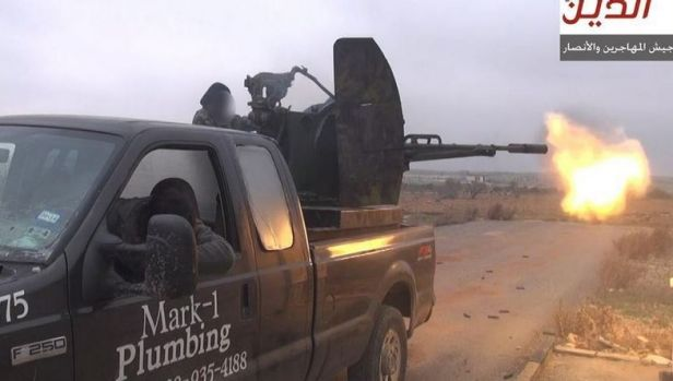 Texan Mark Oberholtzer's old work truck ... Jihadists from Ansar al-Deen Front fight Syrian goverment forces near ...