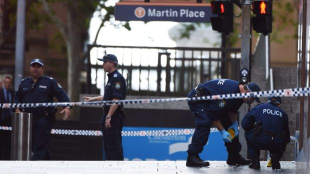 Seeking evidence: Forensic police officers mark out the Martin Place crime scene after the siege ended.