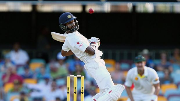 Casualty: Shikhar Dhawan avoids a bouncer playing Australia at the Gabba.