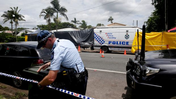 Police cordon off the area around the Manoora house where eight children died.