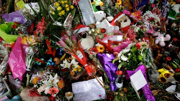 Memorial: flowers and toys left at the home.