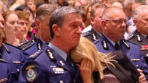 Police Commissioner Andrew Scipione with his wife Joy at a memorial service for the victims of the siege in Martin Place.